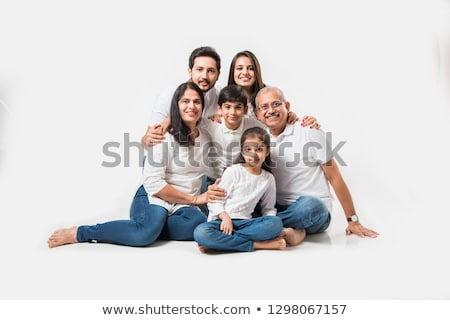 young woman wearing blue jeans sitting on the floor Stock photo © Rob_Stark