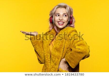 Sorridente loiro peludo fones de ouvido quadro mulher Foto stock © dolgachov