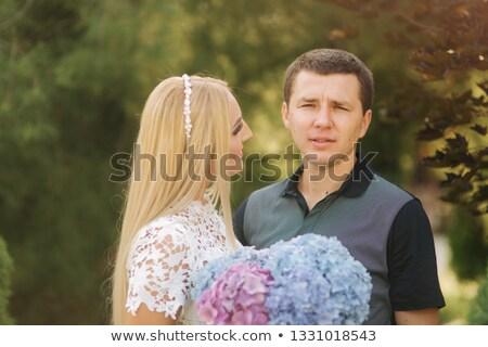 Attrctive couple smiling Stock photo © konradbak