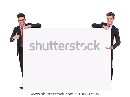 Man making thumbs-up gesture and holding business card Stock photo © photography33