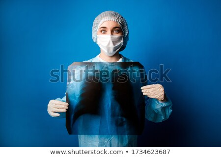 nurse holding a radiology image Stock photo © photography33