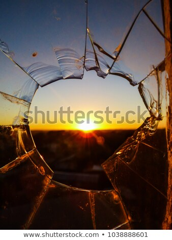 sunlight through broken window stock photo © sirylok