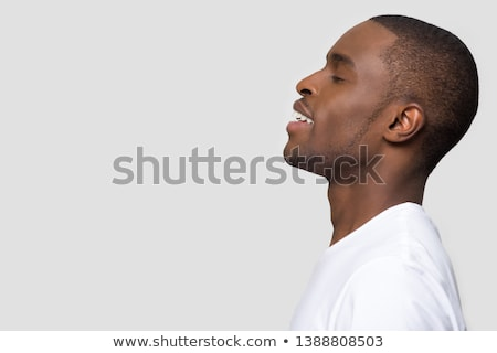 handsome man makes exercises Stock photo © ssuaphoto