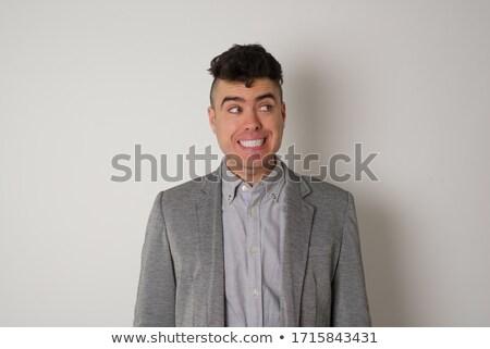 Portrait of a clueless businessman posing against a white background Stock photo © wavebreak_media