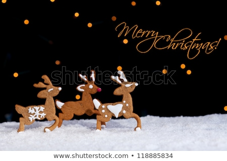 Gingerbread deers running through starry night Stock photo © lightkeeper
