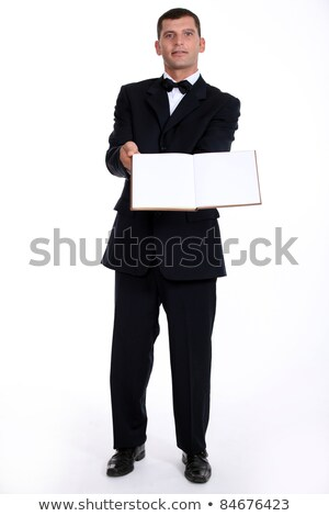 Waitor holding book Stock photo © photography33