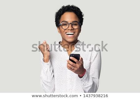 Nő olvas szöveges üzenet mosolyog gyönyörű fiatal nő Stock fotó © stryjek