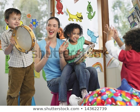 Cute Mixed Race Kid With Tambourine. Stock photo © SLP_London