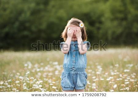 sad little girl crying outdoor green meadow field stock photo © lunamarina