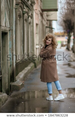 Beautiful young lady posing in wet clothes. Stock photo © PawelSierakowski