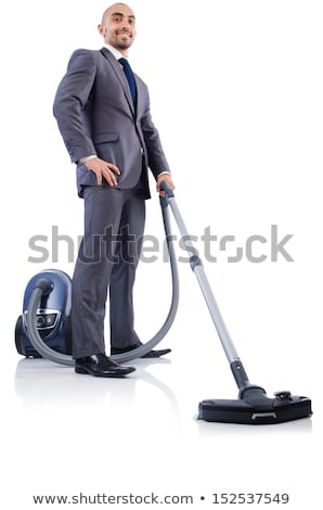 businessman doing vacuum cleaning on white stock photo © elnur