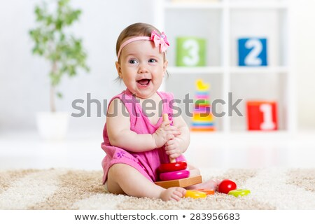 baby girl playing with pyramid stock photo © mikko