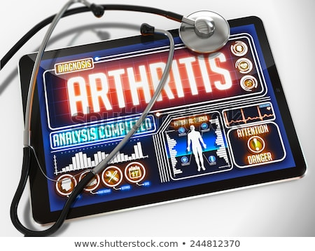 Tablet with the diagnosis rheumatism on the display Stock photo © Zerbor