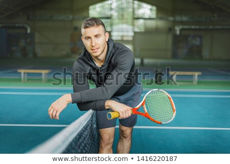Young athletic guy near the netting Stock photo © vlad_star
