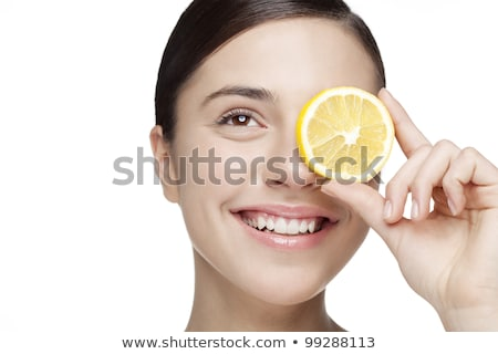 Young Woman Holding Citrus Fruit In Studio Stock photo © monkey_business