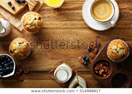 Breakfast table with cakes, coffee and fruits Stock photo © dariazu