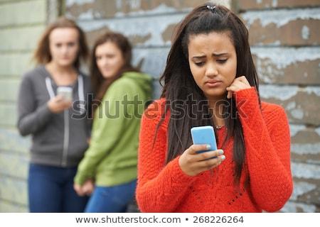 Tinilány szöveges üzenet mobiltelefon szomorú mobil tini Stock fotó © monkey_business