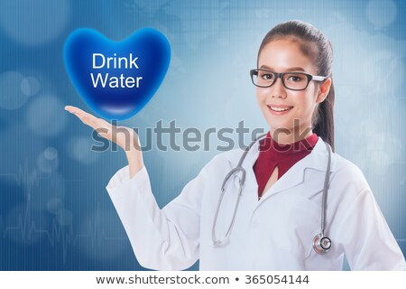 Doctor holding low calorie sign Stock photo © ichiosea