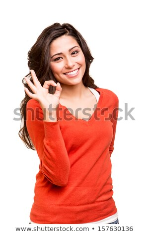 Indian young woman showing ok sign isolated on white background Stock photo © bmonteny