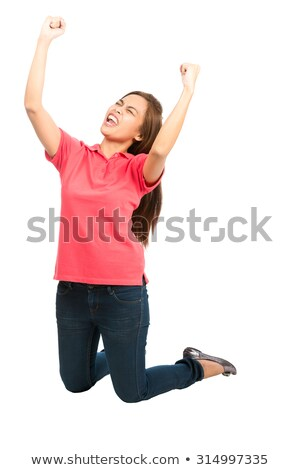 asian young woman punches fist into the air isolated on white background stock photo © bmonteny