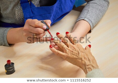 Female fingers with red varnish Stock photo © shawlinmohd