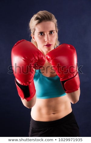 portrait of a young caucasian woman who does kick boxing with boxing gloves Stock photo © ambro