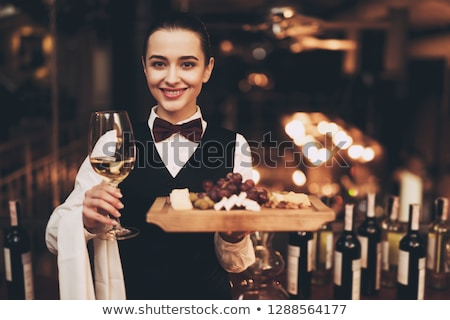 Foto d'archivio: Beautiful Young Brunette Woman Holding A Bottle Of White Wine