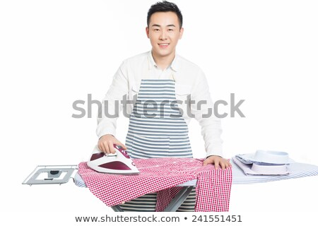 Chinese Young Man Ironing His Clothes Stock fotó © wxin