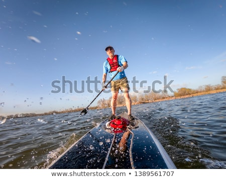 Senior male on SUP paddleboard Stock photo © PixelsAway