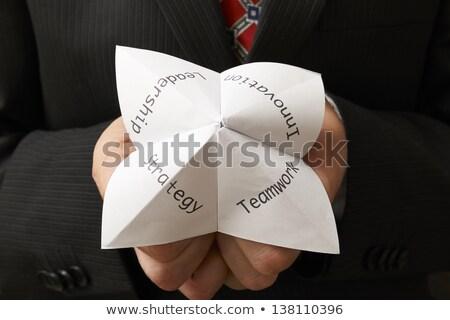 Teamwork on fortune teller Stock photo © fuzzbones0
