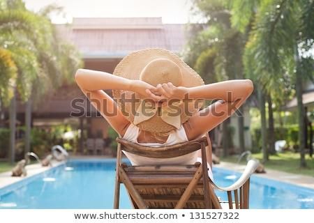 mulher · praia · amarelo · biquíni · oferta · ordem - foto stock © deandrobot