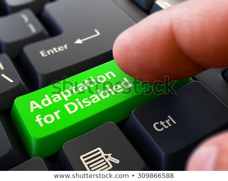 adaptation for disabled   clicking green keyboard button stock photo © tashatuvango