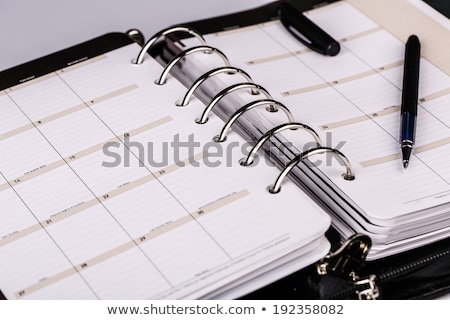 Black, leather, personal organizer on a white background Stock photo © shutswis