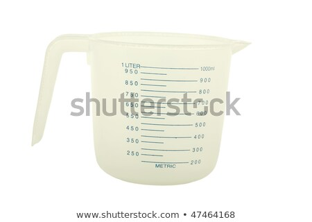 Plastic measuring cup; isolated, clipping path included Stock photo © shutswis