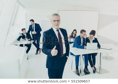 confident senior entrepreneur showing thumbs up Stock photo © feedough