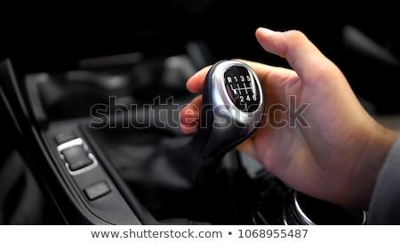Male driver hand shifting gear manually Stock photo © stevanovicigor