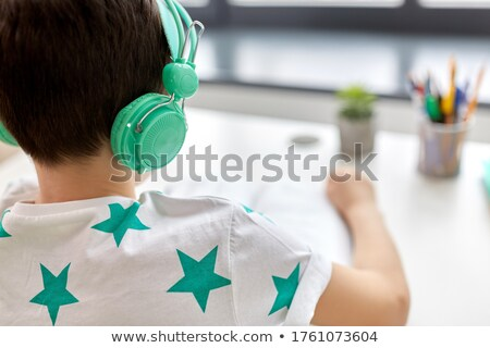 pre teen boy sitting with a book stock photo © lovleah