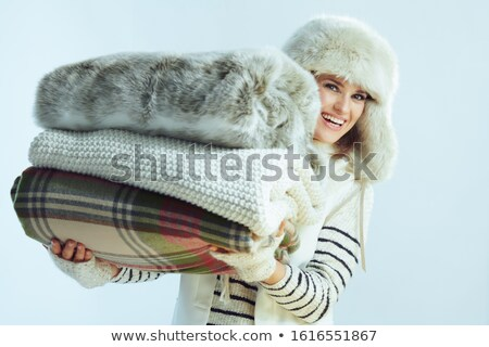 Pretty woman holding rug isolated on white Stock photo © Elnur