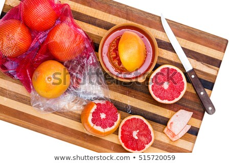 whole and sliced ruby red grapefruit with knife stock photo © ozgur