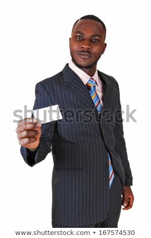 Adult male holding up necktie. Stock photo © iofoto