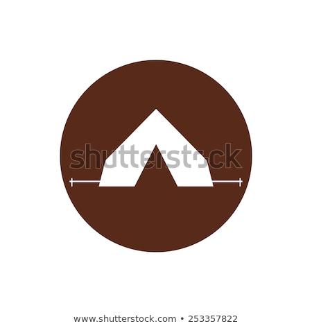 Tourist tent sign icon. Camping symbol. Travel design. Circle flat button. Modern UI website navigat Stock photo © JeksonGraphics