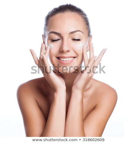Stock photo: Woman with cream isolated on white background