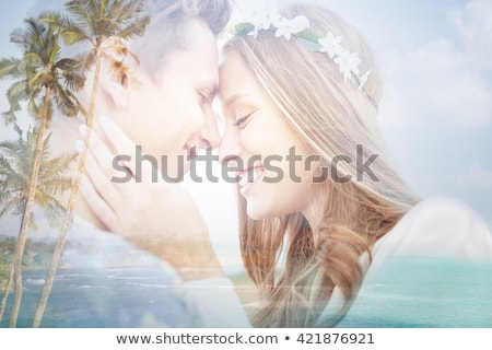 happy smiling young hippie couple over beach Stock photo © dolgachov