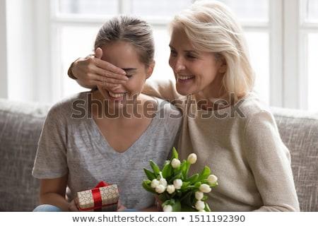 anne · kız · çiçekler · gülen · sevmek · mutlu - stok fotoğraf © monkey_business