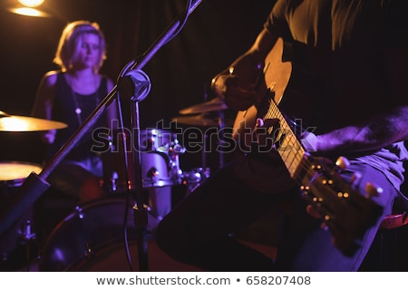 Mid section of drummer performing on stage at nightclub Stock photo © wavebreak_media