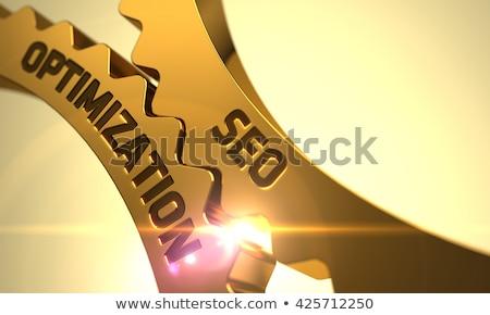 Website optimalisatie gouden metalen cog versnellingen Stockfoto © tashatuvango