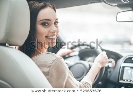 zakenvrouw · rijden · auto · mooie · brunette · geld - stockfoto © is2