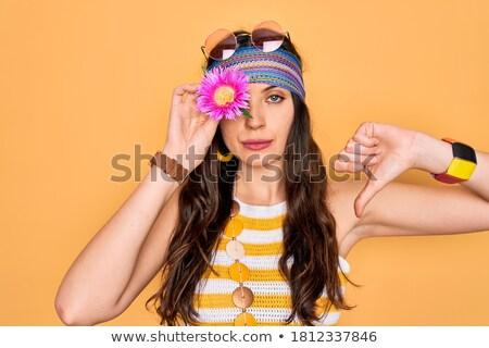 Young caucasian hippie woman with thumb down. Stock photo © RAStudio
