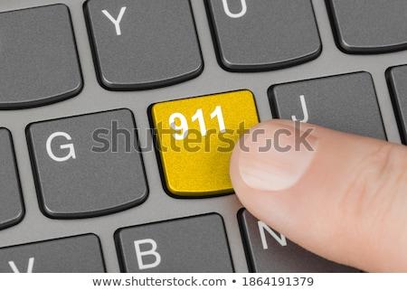 Teclado chave 911 homem dedo Foto stock © tashatuvango