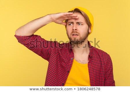 Zavart szakállas férfi póló tart fej Stock fotó © deandrobot